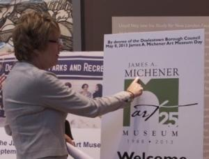 Michener Director and CEO Linda Tremper Hanover shows off the museum's new logo. Photo by Bailey Fucanan.
